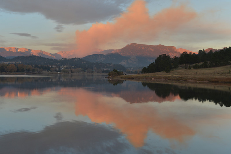 A plume from the Fern Lake Fire rises above Lake Estes on Friday. As of Monday morning, the national park reports that the fire is 30 percent contained at over 700 acres.