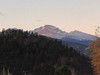 Relatively light breezes blow small clouds over Longs Peak on Thursday morning. Warmer today with light winds and clearer skies. Expect a high in the upper 50s to 60.
