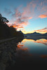 Sunrise paints the lake and sky above Estes Park last week. The change of seasons brings more clouds and more colorful starts to the day.