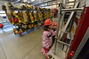 Children read information of the back of a truck while sporting their fire helmets in front of the rack of bunker gear. The event was a fund raiser for the volunteers, helping them secure more equipment to keep Estes Park and the surrounding community safe.