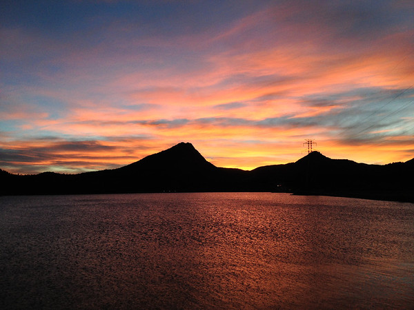 Orange, yellow and blue cover the sky over Lake Estes on Monday. Breezy but warm to day with partly cloudy skies and a high around 66.