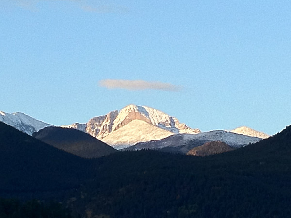 Skies clear over Longs Peak on Friday. It should be warmer and drier today with a high nearing 70.