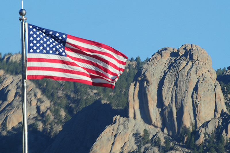 Old Glory sticks almost straight out in Tuesday's wind. The wind is a harbinger of change as temperatures are expected to plummet as much as 50 degrees between Monday and Friday.