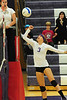 Senior Karin Kingswood punches at a ball last week. The durable Kingswood played all 61 matches for the Ladycats.