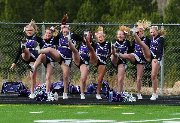 The Estes Park cheerleaders get their kicks at Nederland last week. The girls will cheer in warmer clothes on Friday at the Bobcats' last football game of the season.