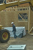 Construction workers put together new homes along Spur 66 on Wednesday. New housing construction is up to its best level since the housing market collaps, good news for Estes Park's home builders.