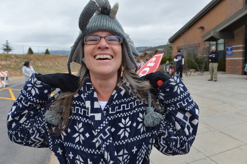 Elementary school principal Karen Glassman shows off her peanut and elephant earrings, matching her warm hat. The school hosted a pajama day as part of their Red Ribbon Week for drug awareness.