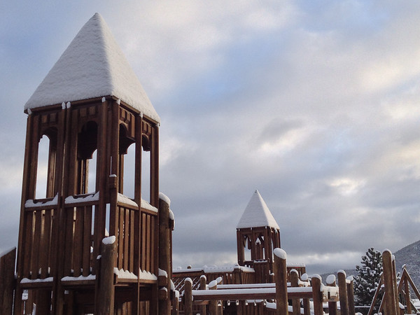 Snow piles up on the Kids Quest playground at the Estes Park Elementary School on Thursday morning. Several inches of snow fell overnight and we have a possibility of more, though clouds were clearing. Expect highs only on the 30s.