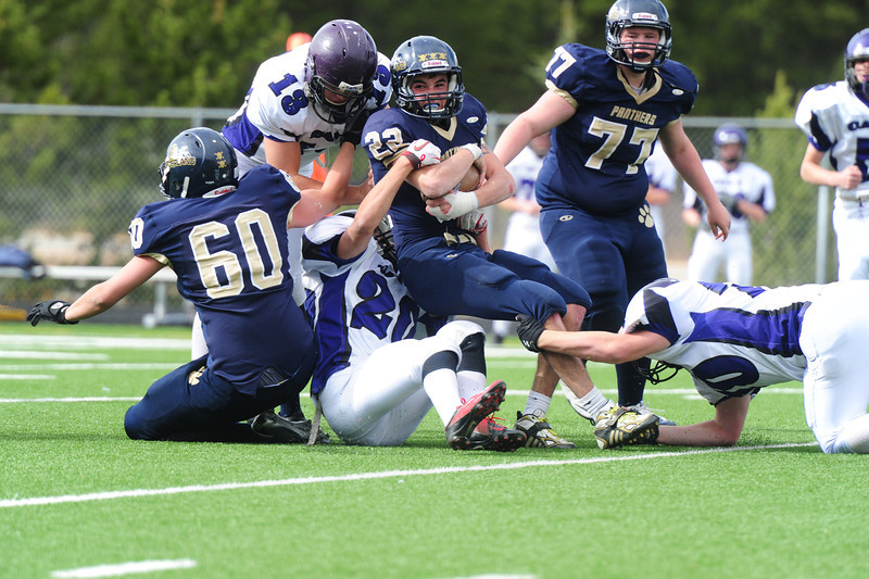 Frankie KellerTwigg (13), Kayle Robidart (20), and Brenden Mulhern combine for a stop on Nederland's Connor Steele on Saturday. The Bobcat defense gave the Panthers fits with interceptions, forced fumbles and sacks throughout the day.