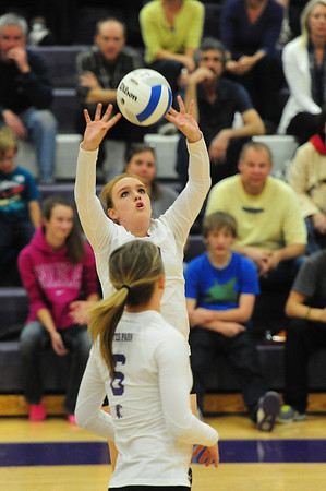 Cora Young sets for her team on Thursday. The Ladycats ended the season on a lossing skid.