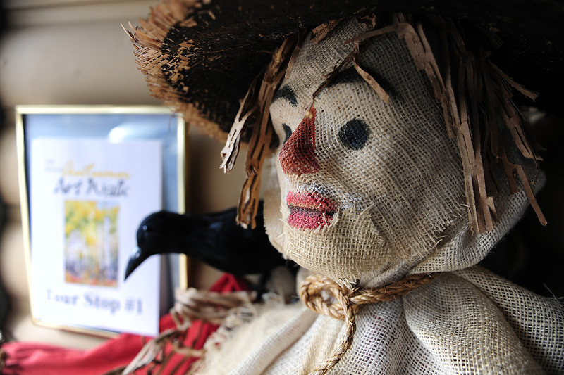 An artistic scarecrow decorates the entryway to the Cultural Arts Council gallery on Wednesday.
