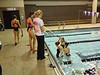 High schools girls swimmers finish up a workout on Thursday. While the official season has yet to begin, many athletes are already preparing on their own.