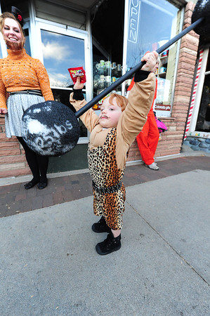 Rocco Fallaci, 2, puts his barbell overhead during Halloween on Elkhorn Avenue on Wednesday night. His family had a side-show theme.