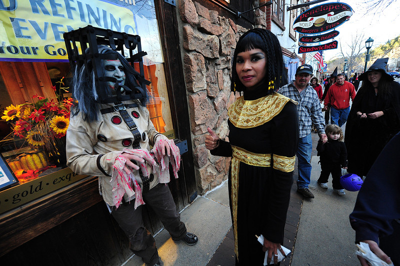 Brenda Lucy, right and Ron Monroe show that Halloween is not just for children in Estes Park. Halloween is the chance for adults to find inner personalities or crazy alteregos.