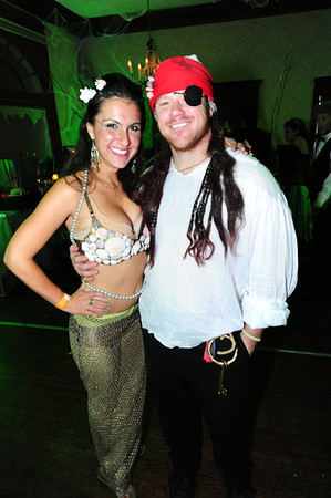A mermaid and her catch take tiome off the dance floor. The Stanley included plenty of libations and snacks for costumd revelers on Saturday.