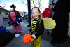 Alison Raymond, 5, buzzes through downtown on Wednesday. Costumes ran the usual range from cute to racy to grotesque for Halloween.