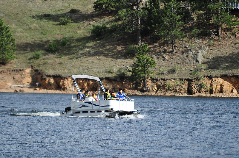Walt Hester | Trail Gazette<br /> A family glides across Lake Estes on Wednesday. As the weather warms, more boats will take advantage of the lake.