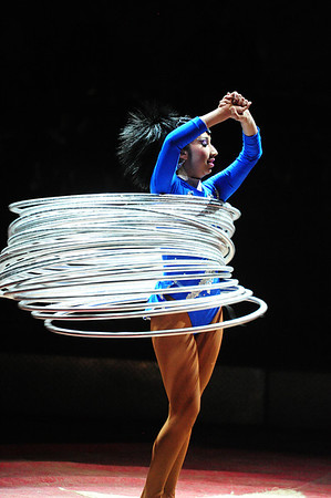 Walt Hester | Trail Gazette<br /> The hula-hoop artist holds up several of the plastic hoops during her performance. She would accumulate 40 hoops.
