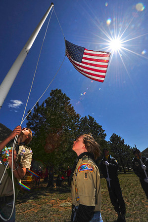 Walt Hester | Trail Gazette<br /> Scouts Sean Cody and Braeden Johnson, 12, raise the American flag over the Estes Valley Memorial Gardens on Monday. The event was part of the annual Memorial Day observance.