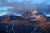 Walt Hester | Trail Gazette<br /> Dramatic first-day's light creates unusual deep red and purple tones in clouds and rock on Longs Peak and its surrounding cirque on Thursday. The sun casts light at an angle that passes through the most atmospher at the ends of the day, creating the colors.