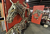 Walt Hester | Trail Gazette<br /> Driftwood horses congregate at the annual Antique and Western Art Show at the Stanley Fairgrounds on Saturday. Artist Monte Michener uses found driftwood to creat his equine sculptures.