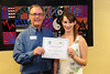 Walt Hester | Trail Gazette<br /> Erin Diedrich receives the Estes Park Board of Realtors scholarship from Scott Thompson.