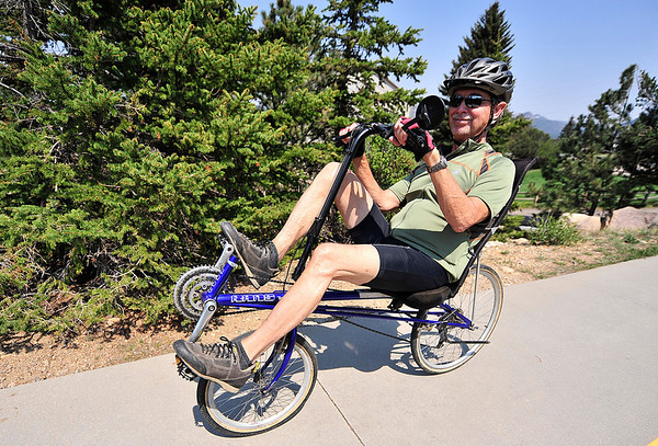 Walt Hester | Trail Gazette<br /> A cyclist enjoys a recumbant ride around the Lkae Estes Trail on Saturday. The unusual bikes allow for a more comfortable ride for those with low back problems.