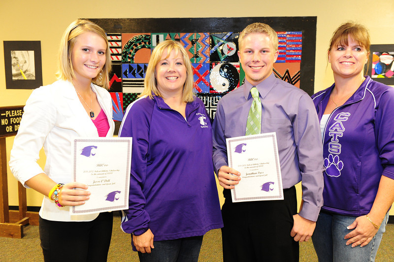 Walt Hester | Trail Gazette<br /> JesseO'Dell and Jonathan Pass receive the BAC'ers scholarship.