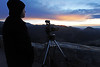 Walt Hester | Trail Gazette<br /> Steve Exendine of Tulsa, Okla., photographs the sky from Rainbow Curve as the sun rises on Thursday. Temperatures are expected to increase as the weekend progresses.