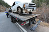 09EPNews Abandoned Wreck.jpg An abandoned Blazer sits on a Bob's Towing truck after being fished out of the Big Thompson River about half a mile down the canyon on Thursday. The Colorado State Patrol had no information on the accident as no driver was found.