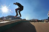 09EPSEar Board Walk_.jpg Brenton Surrett of Estes Park, works on a stunt as younger boarders watch at the Estes Valley Youth Center Skate Park on Wednesday. Some parents have informally organized Wild Wednesdays at the youth center for younger children on early release Wednesdays.