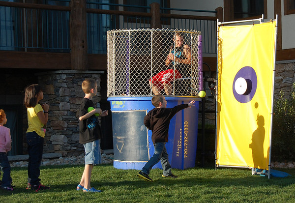 A young marksman lets loose a throw at the dunk tank target at last Saturday's History and Heroes fund-raiser held at Estes Park Resorts on the shores of Lake Estes.