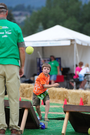 Walt Hester | Trail-Gazette<br /> Zach Lewis of Estes Park launches a ball toward a target during one of the activities at the Biodiversity Festival. Fun and education worked hand-in-hand at the event.