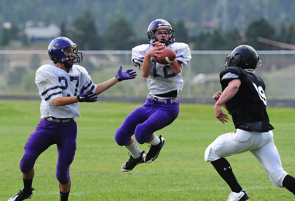 Walt Hester | Trail-Gazette<br /> Joseph Coleson picks off a Roosevelt pass during the Monday scrimmage. The Bobcats' defense, while giving up two TDs to the Roughriders, showed moments of brilliants.