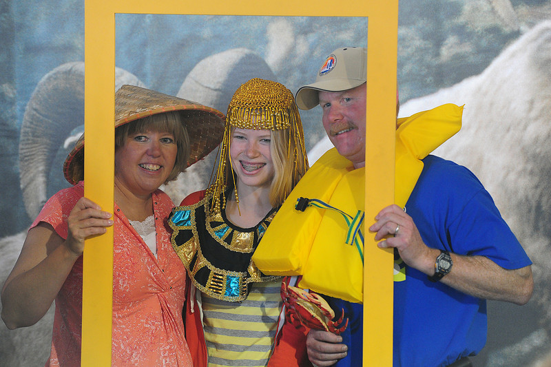 Walt Hester | Trail-Gazette<br /> The Life family of Estes Park pose in the famous National Geographic yellow box at the Biodiversity Festival on Saturday. Some activities were just for fun.