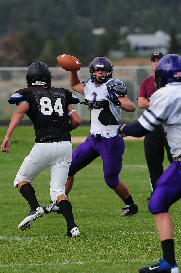Walt Hester | Trail-Gazette<br /> Frankie KellerTwigg attempts a pass during the scrimmage against Roosevelt on Monday. The offense needs some smoothing, but looked like they were coming along.