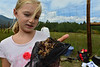Walt Hester | Trail-Gazette<br /> Shalyn Nelson, 10, shows off what she pulled from the stream in Upper Beaver Meadows on Friday. Elementary schools from Denver and Fort Collins took part in cataloging everything they could find during the 24-hour BioBlitz.