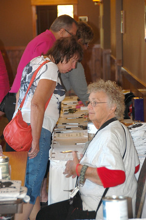 Potential bidders look over items in the silent auction at last Saturday's History and Heroes fund-raiser held at Estes Park Resorts on the shores of Lake Estes.