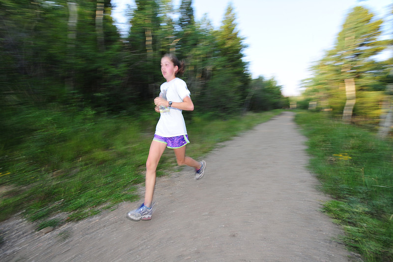 Walt Hester | Trail-Gazette<br /> Speedy junior Kelsi Lasota runs the Homer Rouse trail earlier this month. Lasota knocked almost a minute off of her time from last year's meet, and won the the race for the girls at the Holy Family scrimmage meet this weekend.