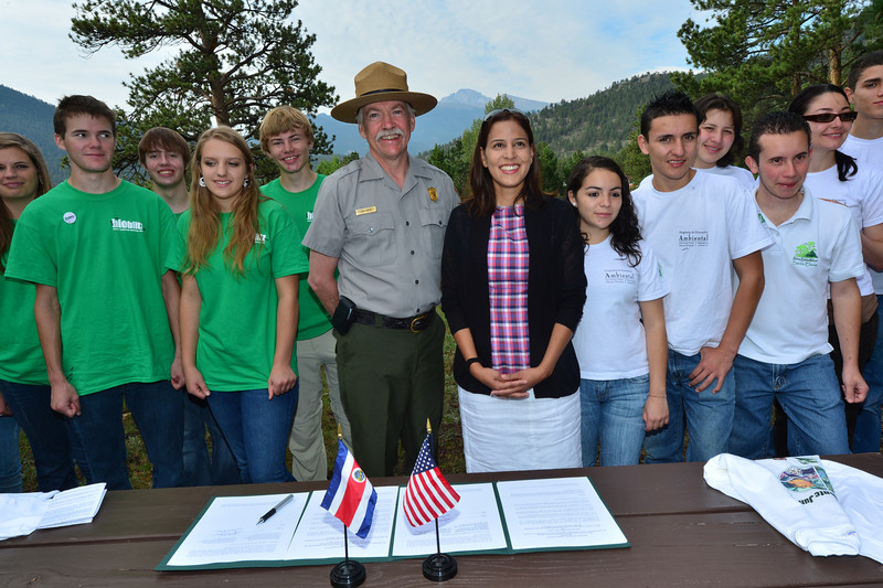 Walt Hester | Trail-Gazette<br /> Estes Park students stand with National Park Service director Jon Jarvis, while Anna Maria Oduber, Minister Council for the embassy of Costa Rica, is flanked by students from Santa Elena High School at a signing ceremony at Rocky Mountain National Park Headquarters on Friday. Director Jarvice signed cooporative aggreement between parks of the two nations.