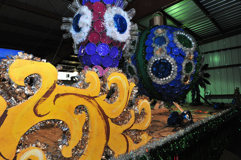 """Giant Christmas ornaments decorate a float at Barn """"W"""" on Monday. The Catch the Glow floats are close to completed and tested for Friday's parade."""