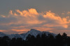 Orange clouds sweep over the high peaks in Rocky Mountain National Park on Saturday. Such clouds are common during the winter months.