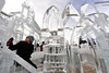 19EP View Ice castle.jpg Walt Hester   Trail-Gazette<br /> Victoria Stockton, 7, of Brighton, Colo., sits in the ice castle maze in Bond Park on Saturday. The castle and maze were part of several ice sculptures around the festival.