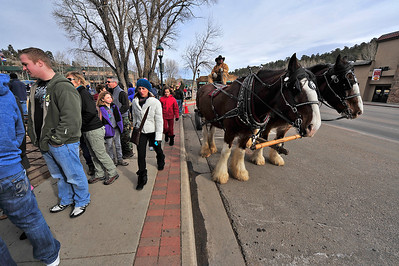 19EP StndAln Horses around.jpg Walt Hester | Trail-Gazette Crowds line up past the wagon ride to get into the Winter Festival in Bond Park on Saturday. The wagon rides were also full for most of the weekend.