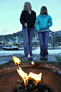 VEWinter Roasters.jpg Walt Hester | Trail Gazette Trista VanBerkum and Whitney Hedgpeth, both of Colorado Springs, roast marshmallows in Bond Park on Saturday. The pair had gotten in their car and headed north, ending up at the Estes Park Tree Lighting.
