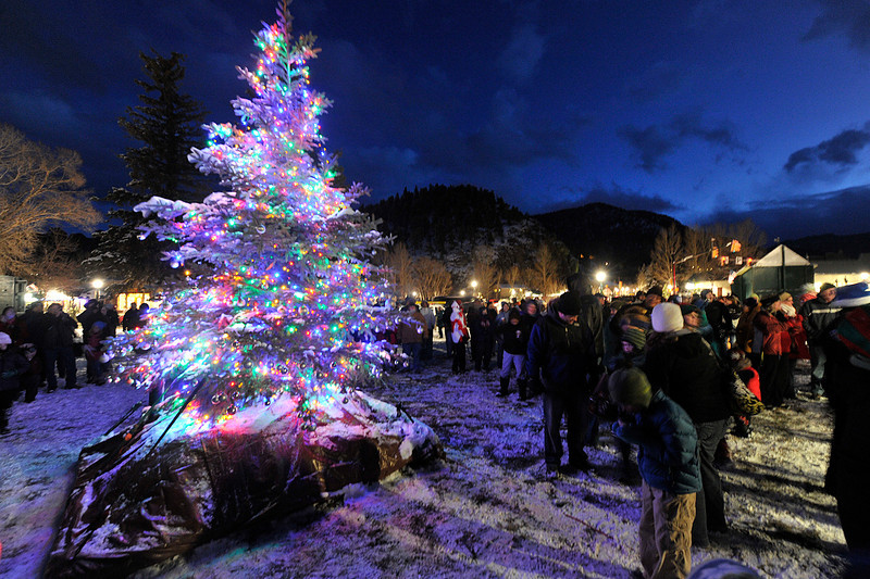 VEWinter Tree Lighting..jpg Walt Hester | Trail Gazette<br /> Visitors to the first Estes Park Tree Lighting in Bond Park on Saturday, break into song as the lights come on. The town and event organizers hope to make the lighting into a new tradition.