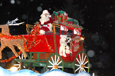 30ep catch the glow santa.jpg By the time Santa made his way down the parade route during Friday evening's 2011 Catch the Glow parade, most of the snow flurries that had hit at the start of the parade had subsided.