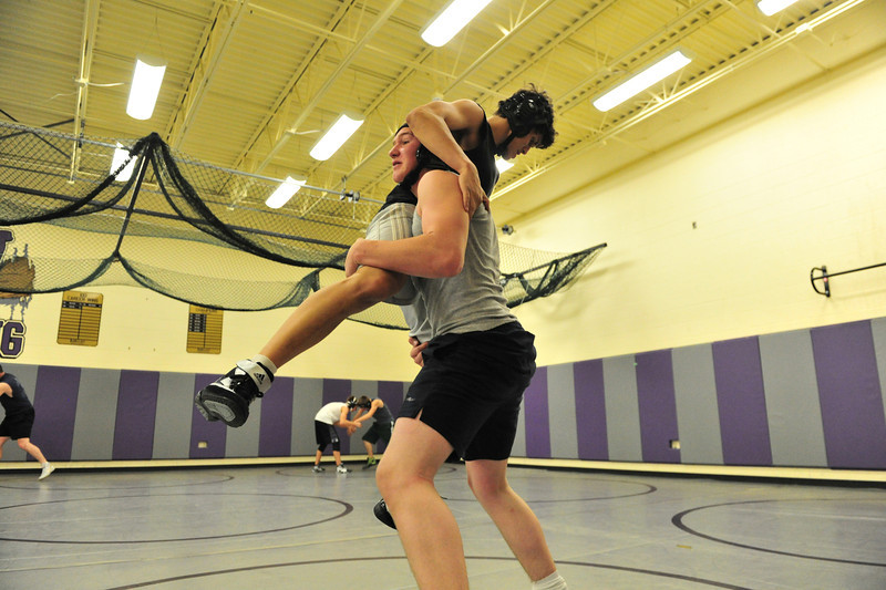 Nick Hawf, 16, picks up and takes down Sean McAlpine, 18, during wrestling practice on Monday. The team travels to their first tournament on Saturday.