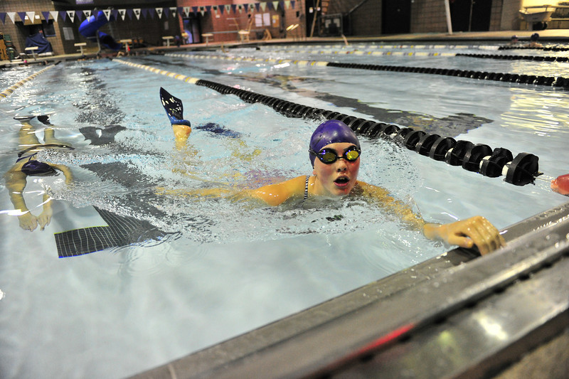 Ladycat swimmers reach for the wall and gasp for breath after completing hypoxic sets on Monday. Hypoxic, or without oxygen, forces the body to adapt by producing more red blood cells and better oxygen uptake.