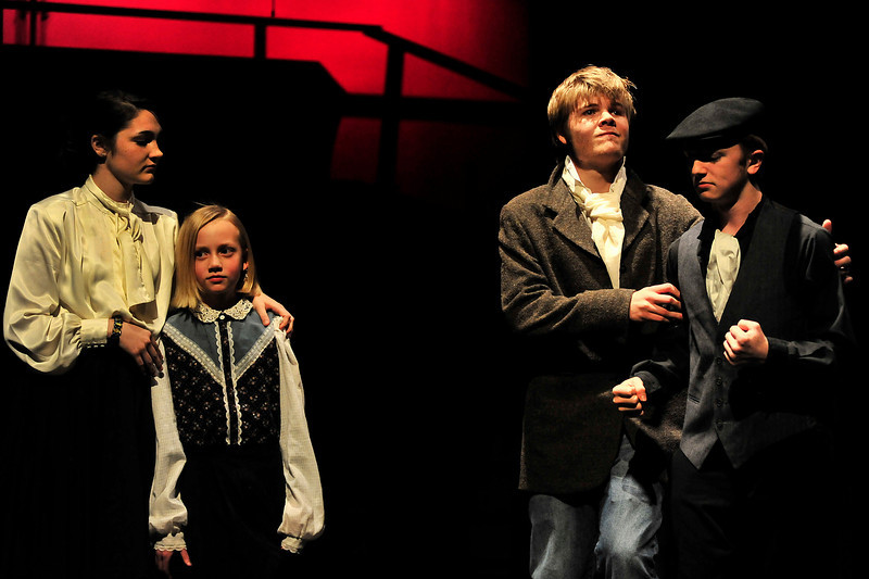 Walt Hester | Trail-Gazette<br /> Madam Thenardier holds the young Cosette as Valjean negotiates with Monsieur Thenardier for the girl's release. The crule and greedy Thenardiers are the only real villians of the story.